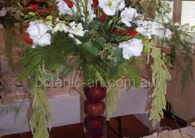 Tall table vase, chlllies and apples
