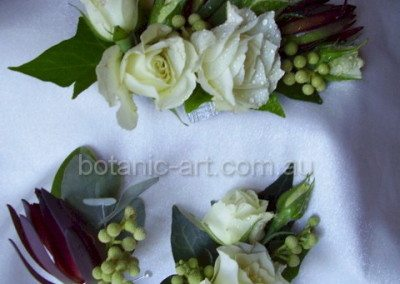 corsage button holes, roses, berries